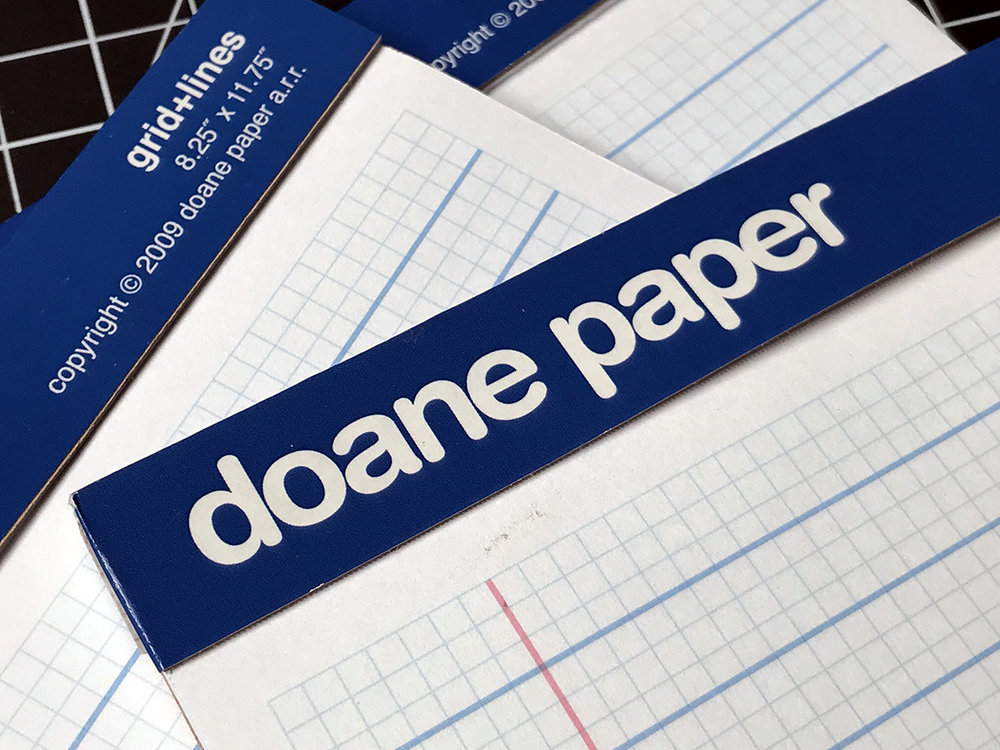 Doane Paper tears out cleanly thanks to a micro-perf at the top and a sturdy cardboard binding.