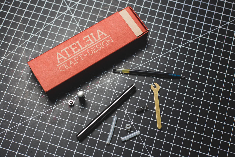 Ateleia pens come handsomely packaged in a cardboard box with a nice outer sleeve, and each one is outfitted with the little wrench shown above as well as some tubing and a spring to act as spacers depending on which refill you're using (depending on the threaded insert).