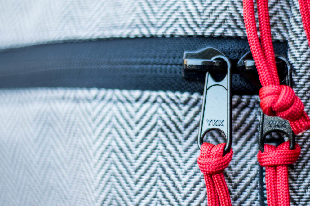 The YKK zippers are nice and YKK is an excellent brand with a great reputation. However, I had to add my own pulls (which I feel are necessary to prevent all that jingling) and I think there are way too many zippers on this bag. One on each of the pockets and two on the top would have been the right amount for me.