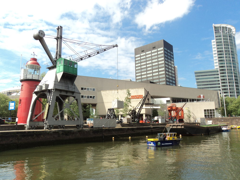 Exterior of the Maritime Museum with part of the mini-harbor of boats and cranes. (My photo, 2018)