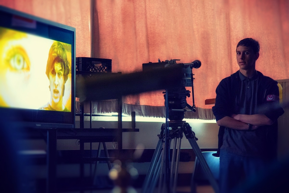 """Noah Talavera-Greenberg, founder of Hamptons Filmcraft, presenting his class project """"Angel by Theory of a Deadman"""" at the 2015 Five Towns Media Arts festival."""