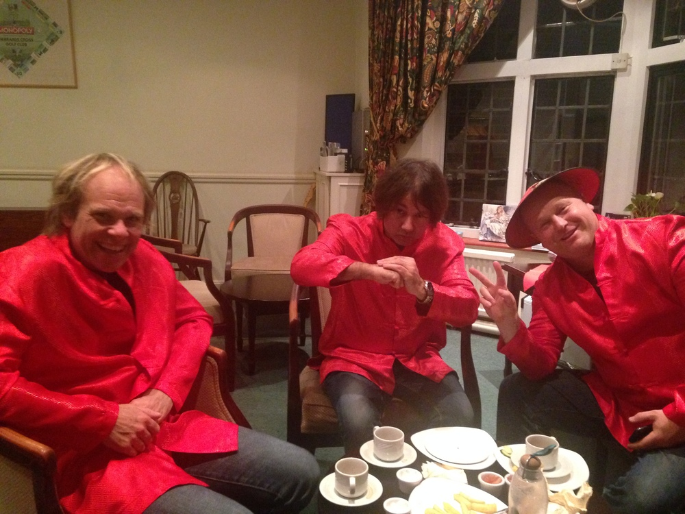 Gareth (drums), Rob (bass) & Al (guitar) having a coffee in Chinese Fancy Dress before the first set!