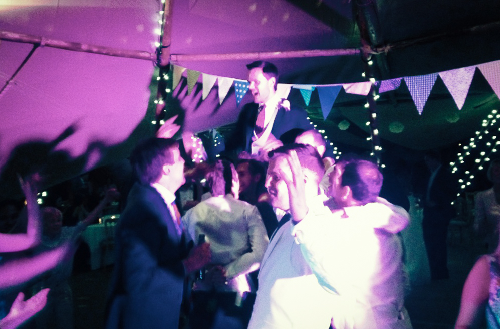 Groom on friends' shoulders, whilst the band play an Oasis tune (his fav band)!