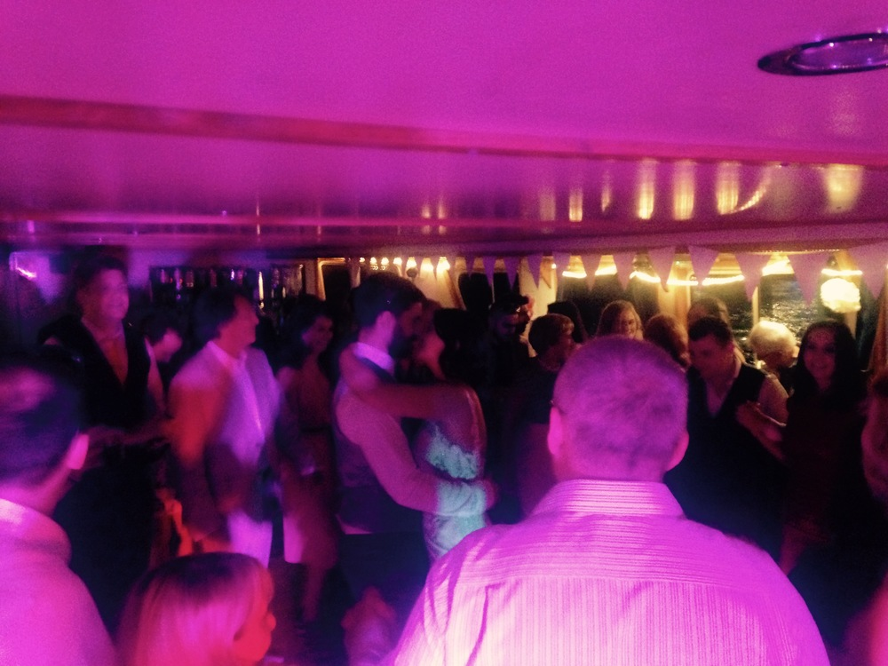 Bride & Groom and guests on the dance floor, Golden Sunrise on The Thames