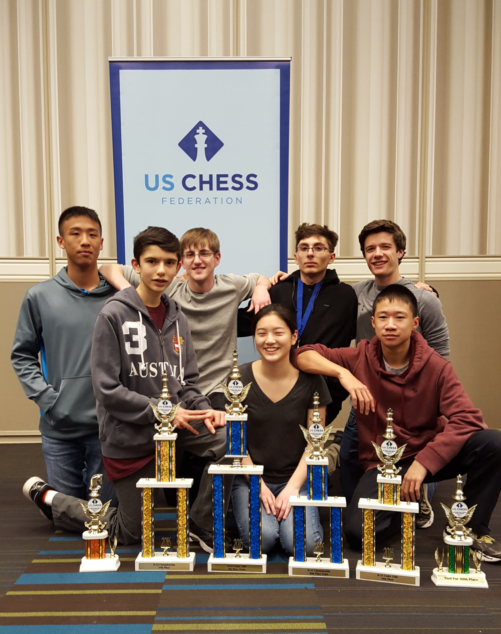 High Tech chess team members with some of the hardware they captured recently at the National Chess Tournament in Atlanta.
