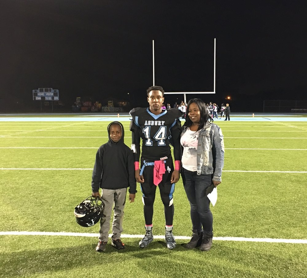 Namir Agrilagos on Senior Night with his mother and younger brother.