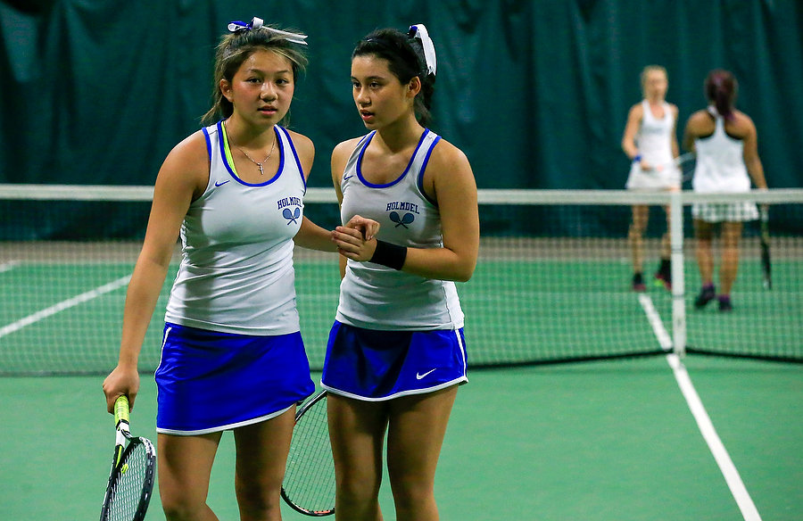 Above right Vickie Vought talks strategy with her doubles partner.