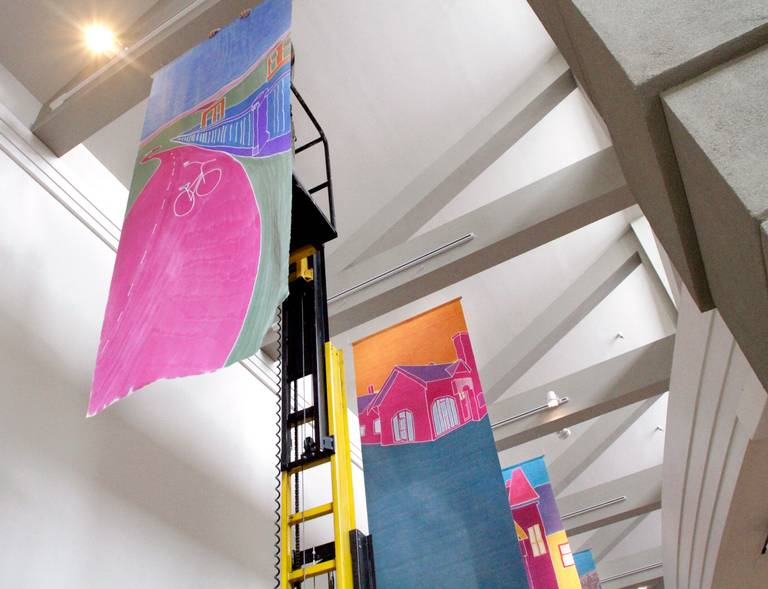 The 4-foot by 10-foot paintings will hang from the ceiling in the galleria. photo: ROBIN TRIMARCHI