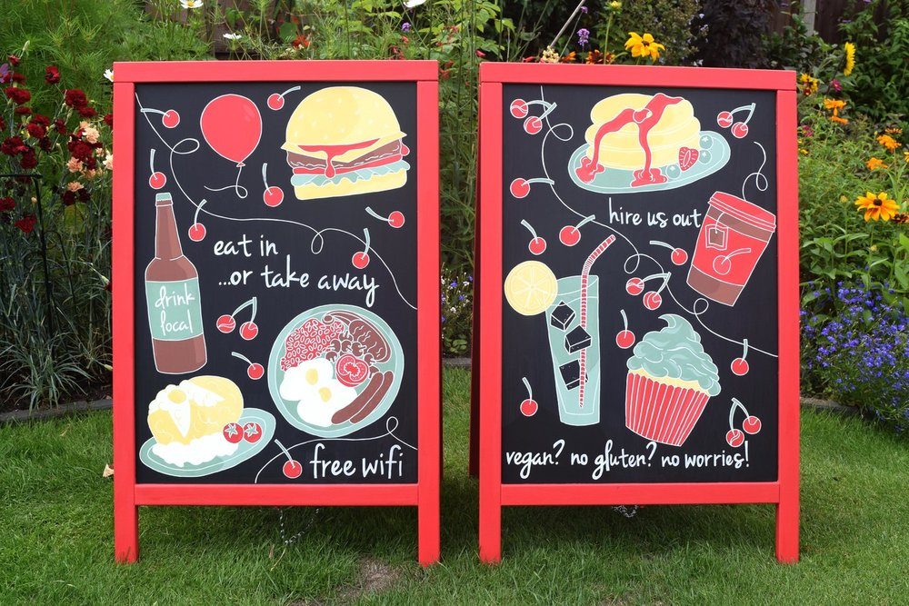 Hand painted a boards for cafe with lettering and food and drink illustrations.