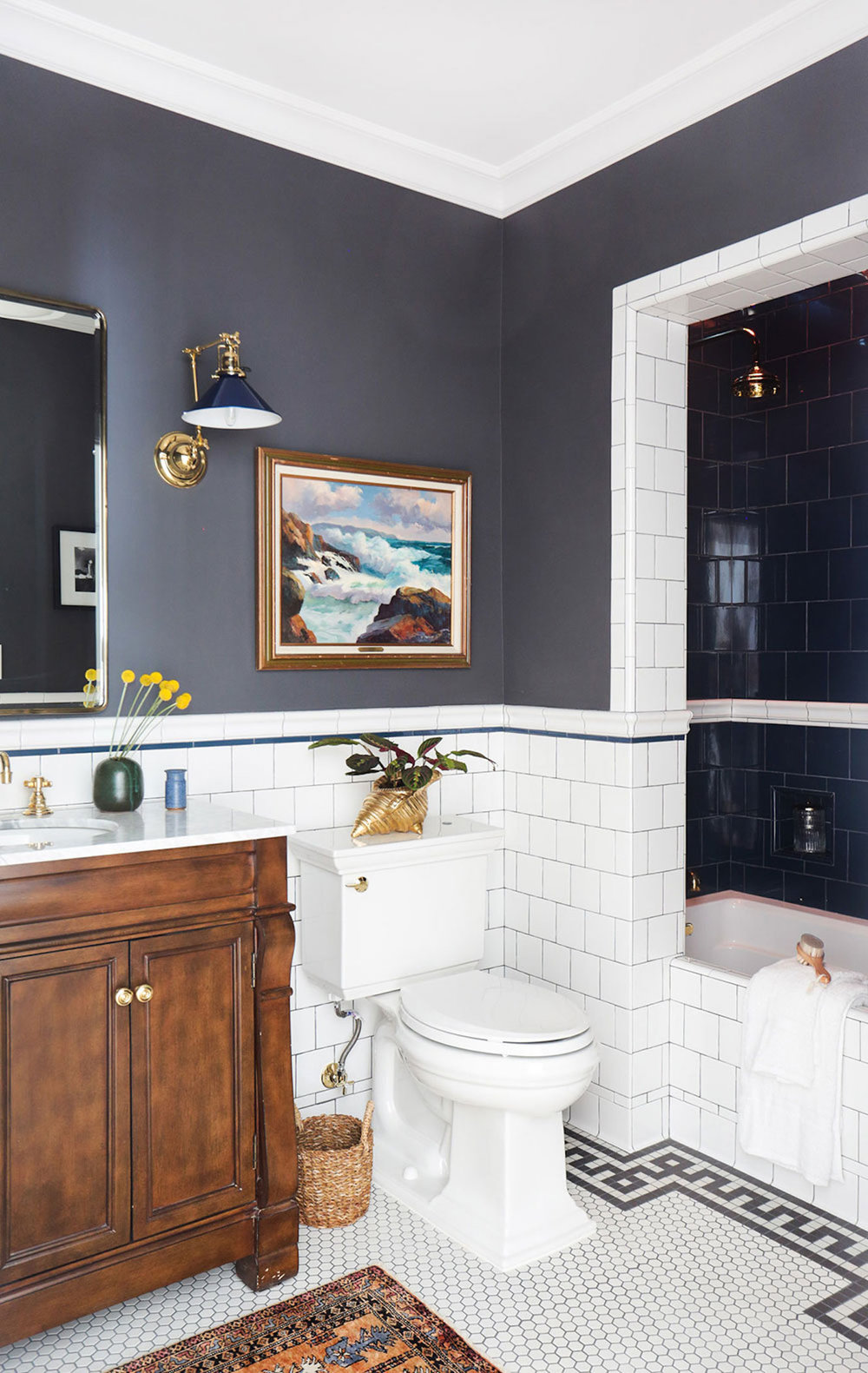 Top 10: Most Popular House & Home Pinterest Images In February - A mix of tile styles create an eclectic look in this bathroom while a warm wood vanity and rug act as the accent pieces.