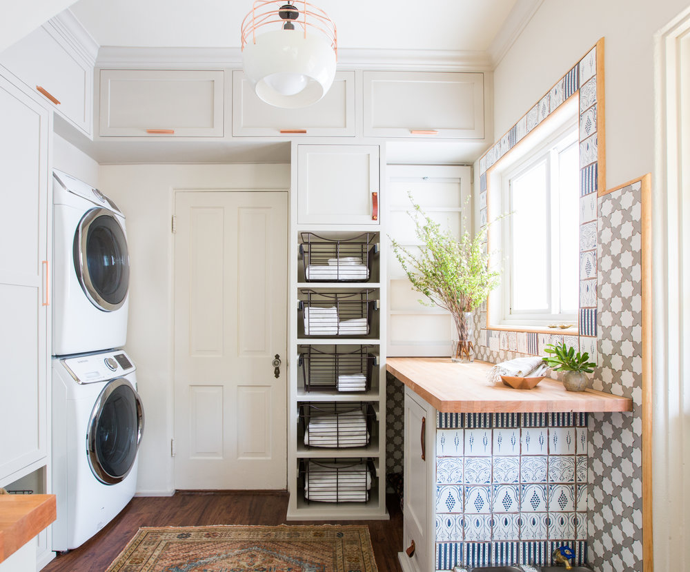63-Square-Foot Laundry Room Fulfills a Long Wish List - By Brenna MalmbergThe reconfigured room gave the main client her dream laundry room. When designer Stefani Stein initially met up with her to discuss the remodel, the wish list was long. But, if planned and packed in correctly, it was doable. The list included a folding area, a drying rack, storage, pullout laundry baskets, a stackable washer and dryer, a utility closet, cat food storage, a pet water station and a dog bed.  full story