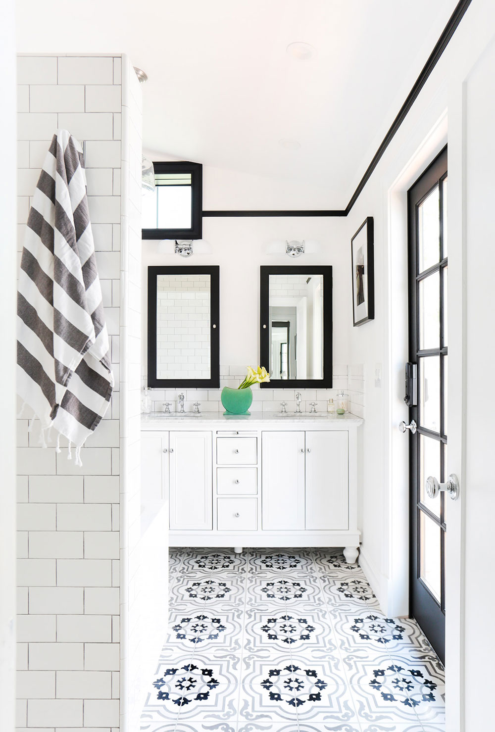 Bathroom Inspiration Trend: Black And White - BY ANABELLE BERNARD FOURNIERWith plenty of white to spare, this black and white bathroom is a light, minimalist design with an especially great flooring choice.To avoid making this room seem small and claustrophobic, the design here is focused on white (and a lot of it!) with black to accentuate mirrors, windows and doors. The touch of color via the flower vase on the countertop is just the perfect amount, and enhances rather than distracts from the overall design.And, of course, the flooring is possibly the best thing about this space. This wonderfully ornamented mosaic tile adds movement and visual interest, and stands in contrast to the more geometrical, minimalist style of the rest of the room.