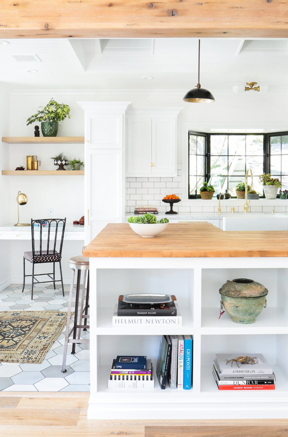 These Kitchens Prove That Subway Tile Backsplashes Will Never Go Out of Style by CHRISTIE CALUCCHIA -  The kitchen is often the focal piece of a home. Although it can be seen as utilitarian, its aesthetic features shouldn't be overlooked. After you've picked your appliances, found an accent rug, and chosen the perfect cabinets, it's time to consider the backsplash.Subway tile backsplashes have long been a go-to design element and for good reason. The glossy tiles are timeless and there is a wide spectrum of variations that can be made to match your personality and your home's décor. Branch out with new materials like marble or vary your layout with a herringbone or crosshatch design instead of the traditional horizontal stack bond approach. Take a look at these stunning kitchens for some much-needed design inspo.