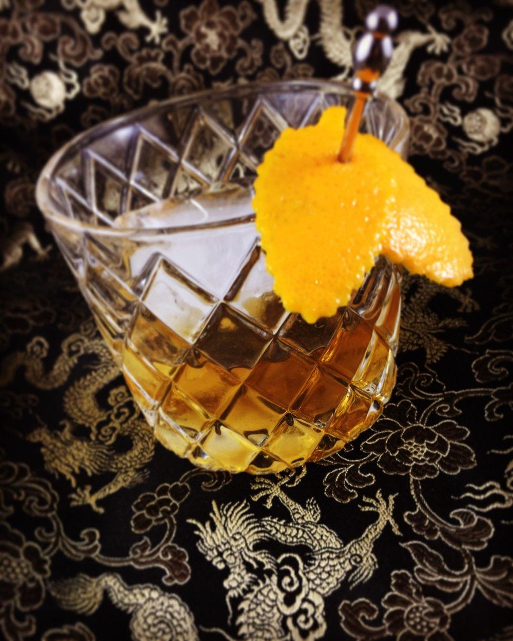 Charred Mandarin Duck Cocktail.
