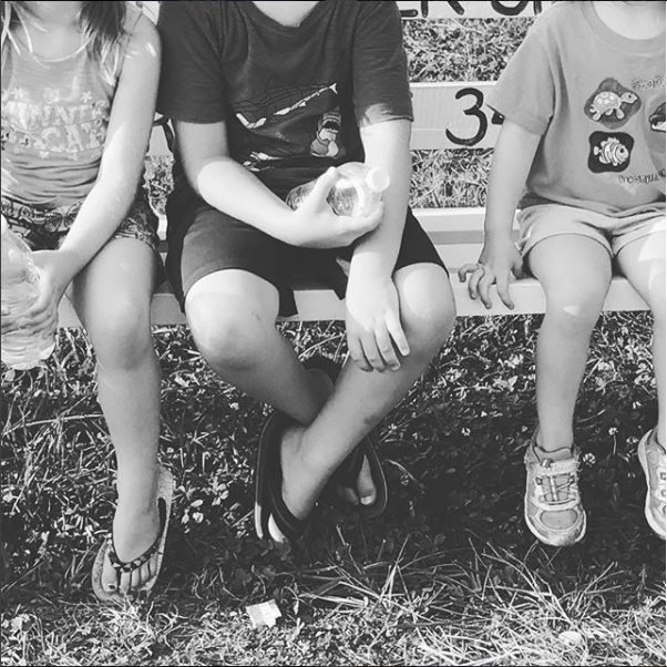 Kids-At-Morgan-County-Fair-Sitting-On-Bench