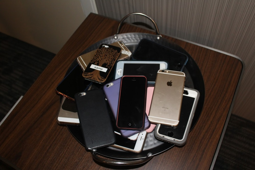 Phones in a pile off to the side so no one found out early...