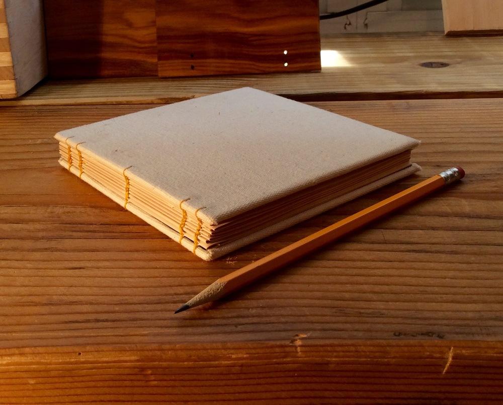 board journal, coptic stitch
