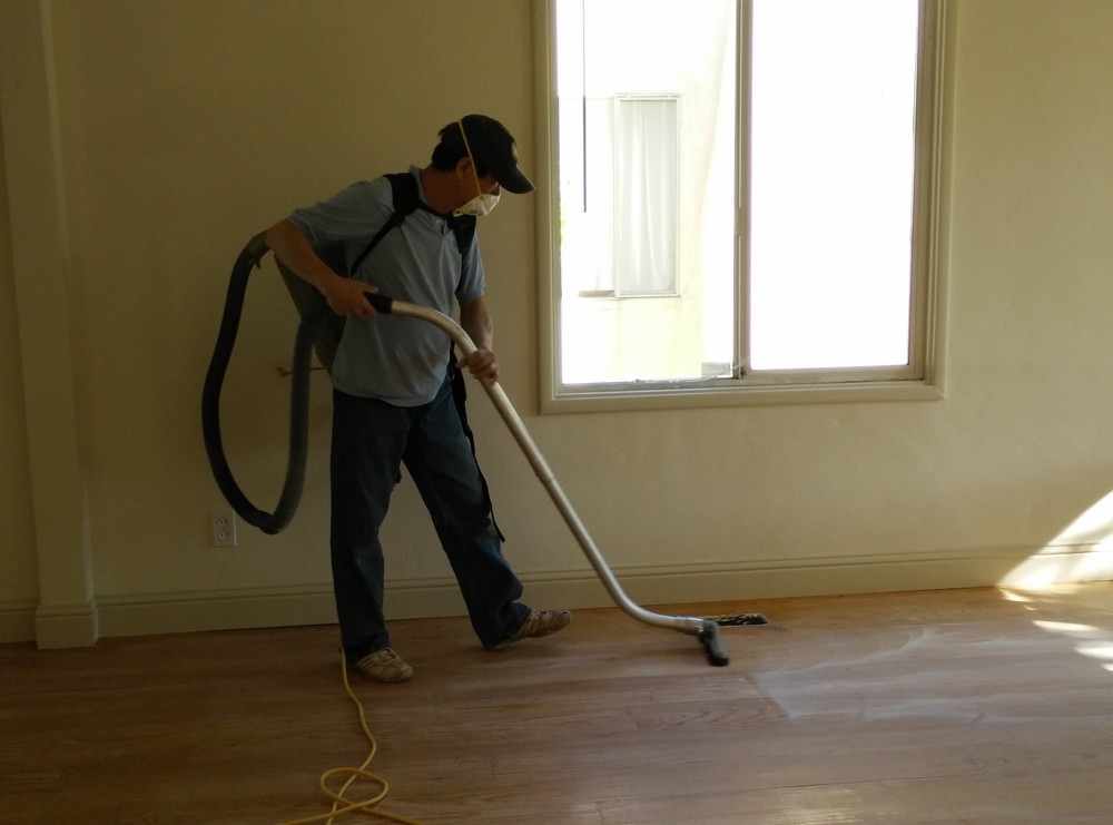 We vacuum the floors before and after every sanding process to ensure the refinishing process is at its best.