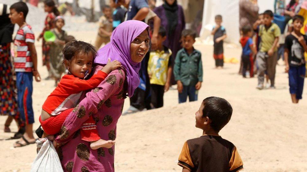 refugee family from web.jpg