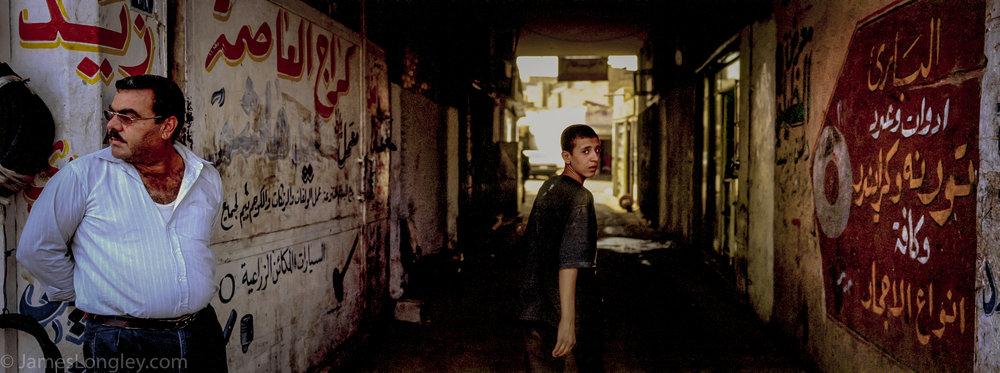 An auto-repair district in Baghdad, 2002