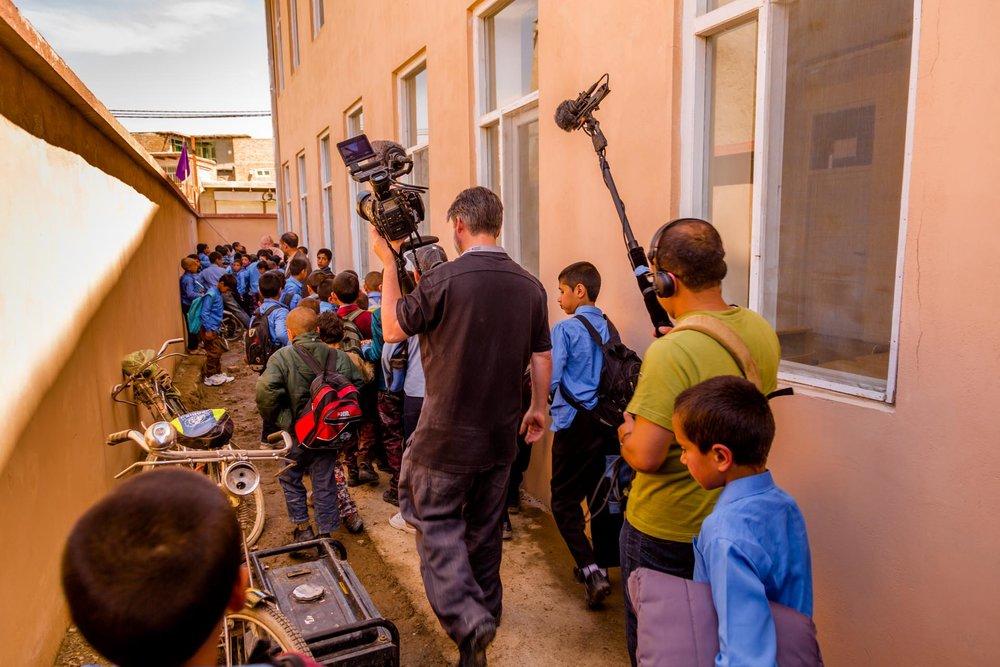 With recordist Jamshid Amiry filming at the Daqiqi Balkhi school
