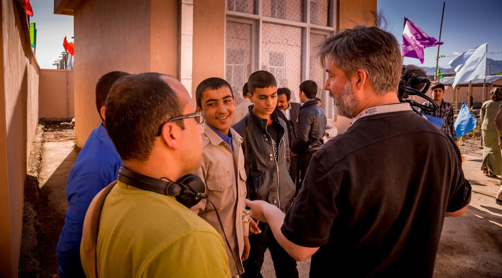 James Longley (right) with Jamshid Amiry, talking with students in between filming at the Daqiqi Balkhi school in Kabul, Afghanistan