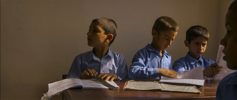 Film still: students in the newly-constructed Daqiqi Balkhi school during the filming of Angels Are Made Of Light