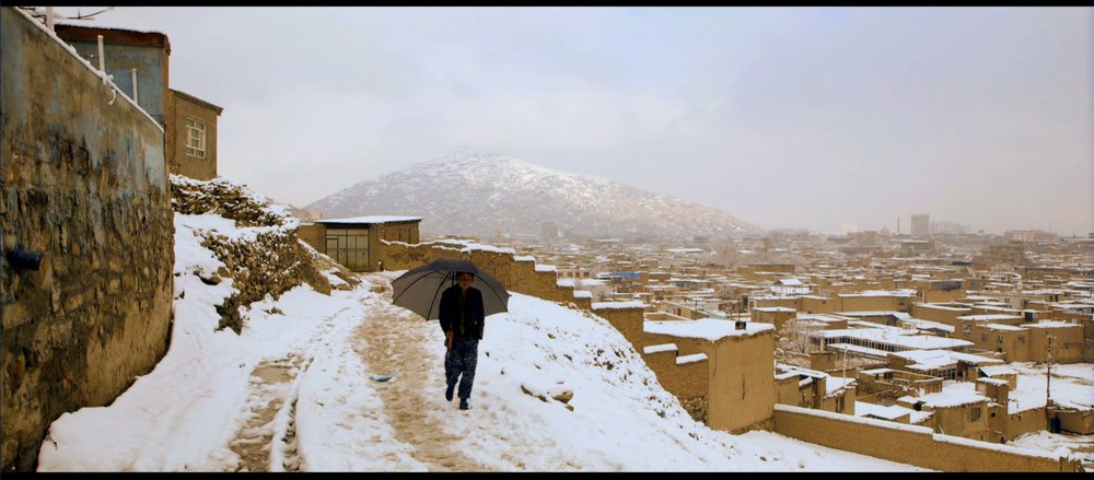 Film still: A snowy day in the neighborhoods above Kabul