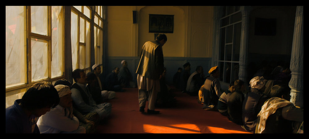 Film still: In a neighborhood mosque, Eid prayer is about to begin