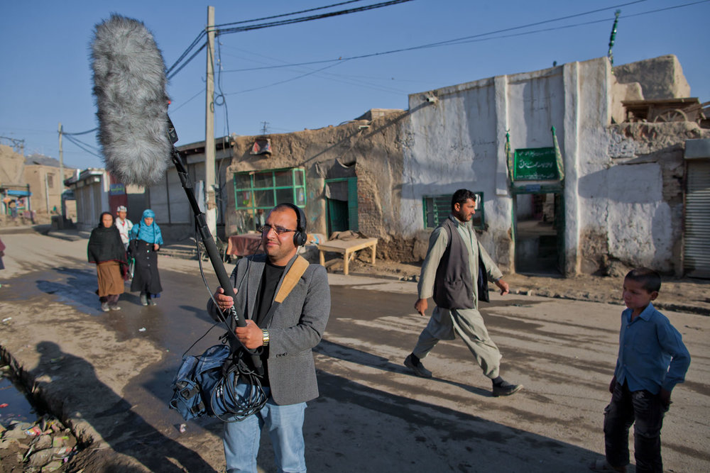 Jamshid Amiry recording surround sound using an inverted SoundField ambisonic microphone near the Daqiqi Balkhi school, Kabul