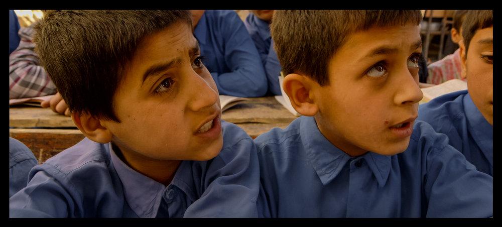 Film still: Sohrab (left) during a classroom scene filmed for Angels Are Made Of Light