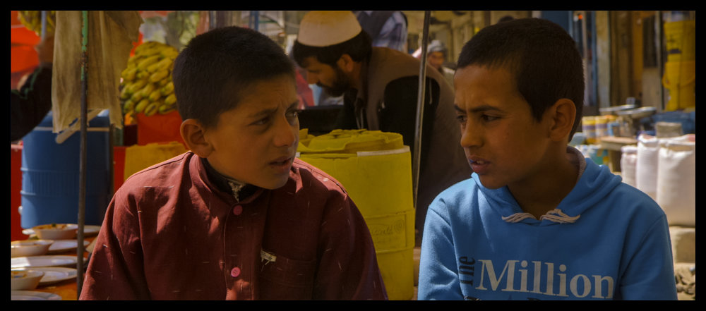 Hikmat (right) talking with his friend, Nabiullah, who is featured in Angels Are Made Of Light; Hikmat's interview - about the death of his younger brother, Naveed, in a suicide bombing - was not used in the film, but the transcript is available to read: