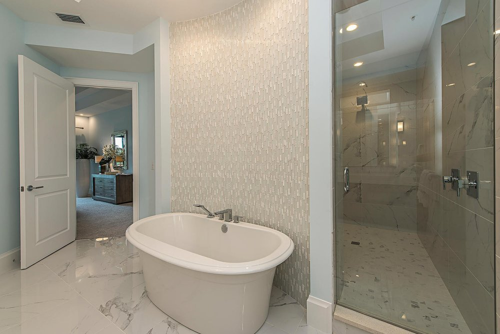 Corsica Model Naples FL 34110-large-027-10-master tub and shower-1499x10....jpg