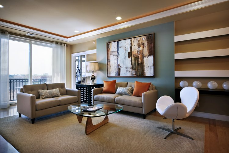 Living room designed on trend with modern and traditional cream pieces.