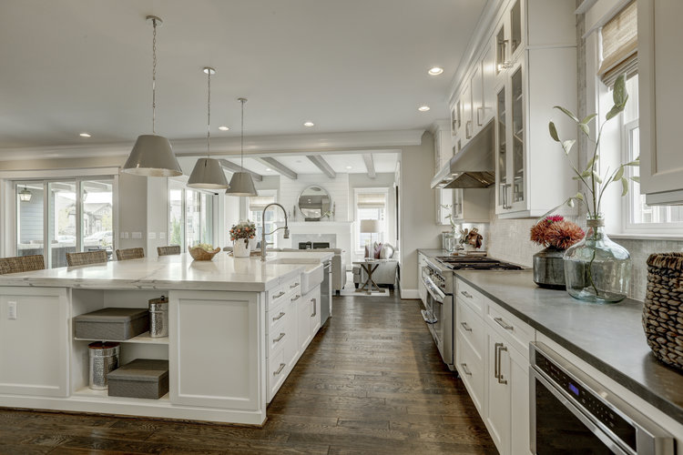 Design trend of sophisticated farmhouse white kitchen and wood floor.