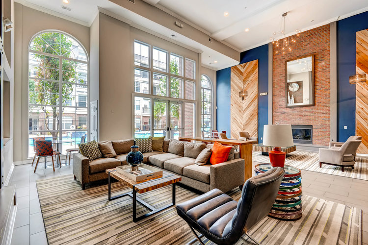 Spacious floor plan with high ceiling clubhouse interior designed with bright colors