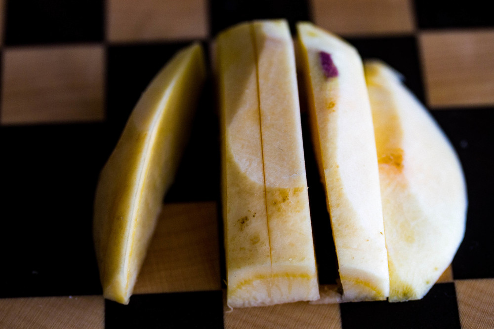 Thinly slice each rutabaga into strips