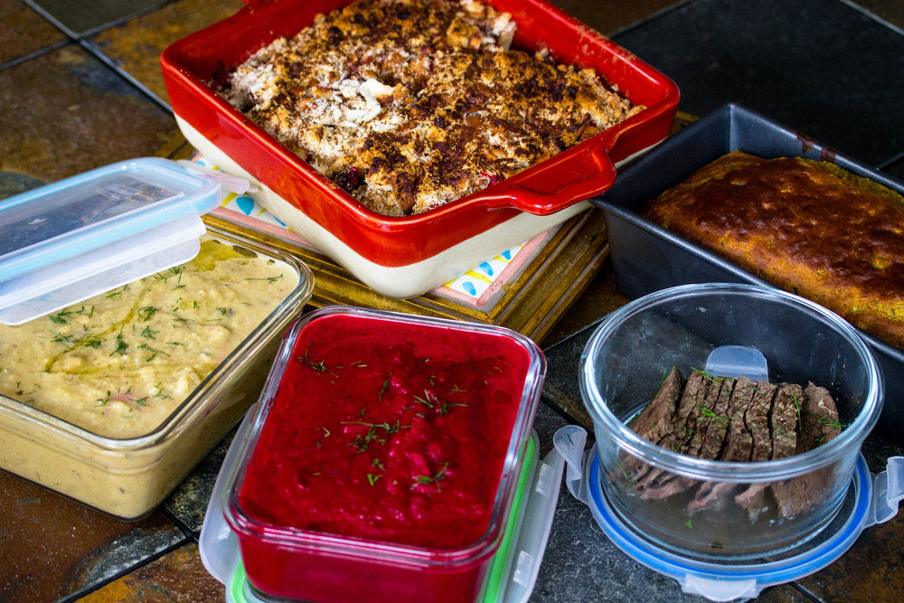 Meal prep is the key to eating healthy as outlined in the 70/30 Plan. Pictured from left to right: Rutabaga Leek Soup, Beet Fennel Parsnip Soup, Better Than Apple Pie Apple Crisp, Elk Roast, and Protein Banana Bread.