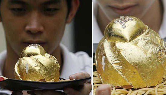 """a diamond-studded blob of chocolate cake. The $2,569 dessert is covered in 24-karat gold leaf and encrusted with 15 sparkling African diamonds. A 21-year old businessman, Angelito Araneta Jr, got his catering company to come up with this diamond-studded cake for use as a marriage proposal gift,"""" BornRich says."""