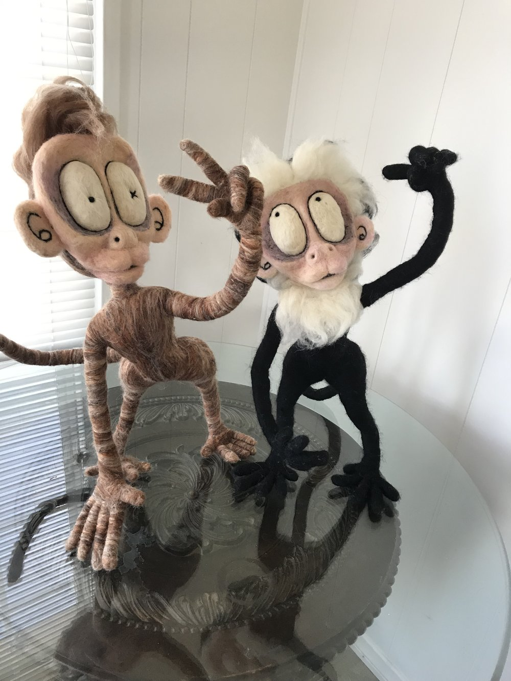 """This is a pair Tawnie recently felted. """"Grasp"""" on the right is modeled after a Capuchin monkey!"""