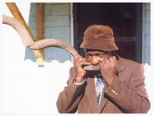 Solomon Guwazah, a railway clerk and musician who lives in the small Zimbabwean city of Rusape, converted from Rastafarianism to Judaism several years ago when he decided that his people, the Shona people of Southern Africa, very likely descended from the ancient Jews. He, and many other community members who have come to the same conclusion, based this belief on the fact that many Shona cultural practices are more similar to those found in the Old Testament than to those practiced by Zimbabwean Christians. He is shown here blowing a  shofar  made of a kudu horn.