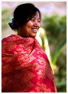 Khandam Nodiel Ngaihte, a member of the Beith Hallel congregation, wears a typical shawl of her home Churachandpur region. She often spends long hours at the loom knitting traditional tribal shawls and, lately, Jewish prayer shawls (tallisim) and skullcaps (kippot). Benei Menashe women began producing their distinctive tallisim and kippot because their husbands could not afford to buy them. Their natural talents soon made these handcrafted Jewish prayer articles among the world's finest. Today, the Benei Menashe hope to support themselves against the dire Manipur economy through production and sales of Jewish items to fellow Jews around the world.