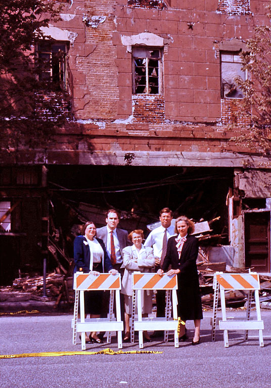 Greater Houston Preservation Alliance members stand in front of the Kennedy Corner Building, Travis at Congress, during its demolition in 1992. / PH file photo