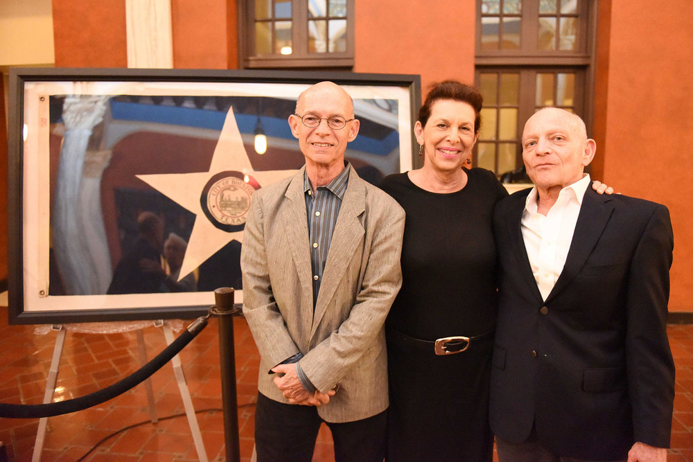 PH Director Emeritus Bart Truxillo (left) and textile conservator Jessica Hack (center), who restored the flag /  photo by Daniel Ortiz