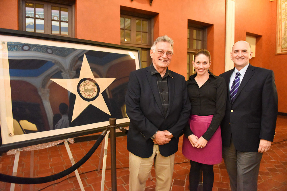 (from left) Frank Descant, who donated the flag to Preservation Houston; Houston Metropolitan Research Center Director Laney McAdow; PH Acting Executive Director David Bush /  photo by Daniel Ortiz
