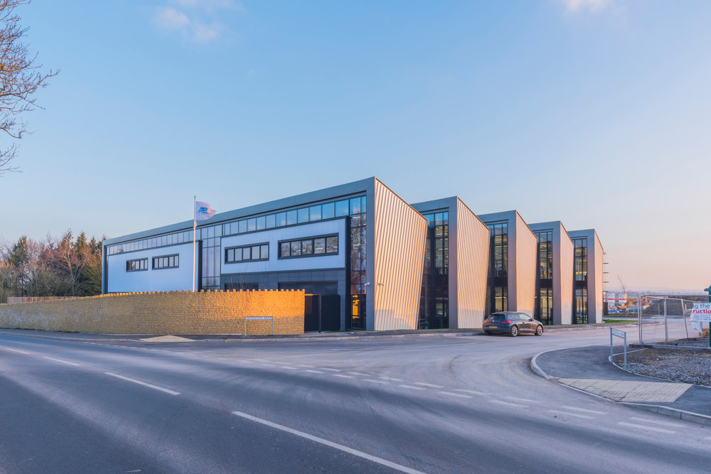 The building from the B3109, Holt Road. The new headquarters signals growing optimism in the industry and is a major driver of high-value employment in the Bradford-on-Avon area.