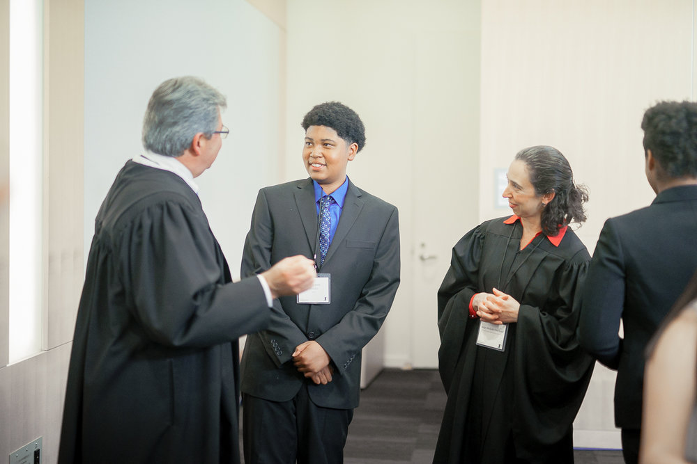 Moot Court Debater Gustavo receiving feedback from the Judges