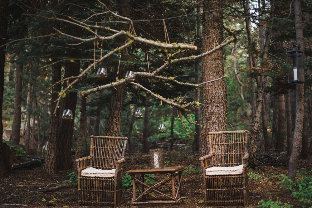 MAGICAL SETTING - Floating candles and mossy branches compliment this outdoor wicker setting beautifully.