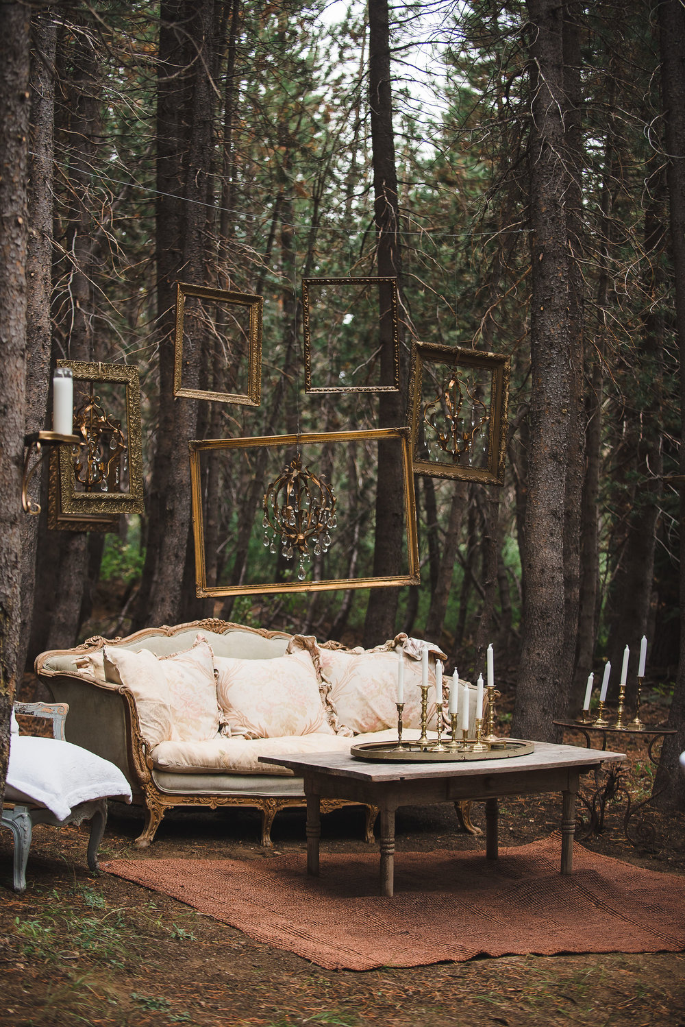 VINTAGE FURNITURE - The perfect combination of vintage furniture and drippy candles make for a rustic outdoor ambiance.