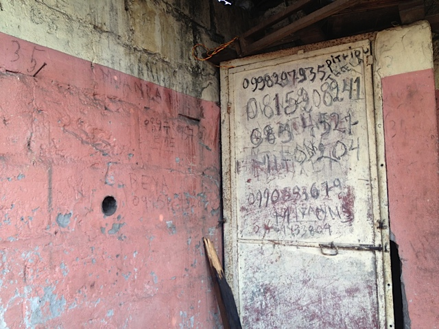 writings on the wall - phone numbers as markers of belonging - Ndjili July 2014 (copyright Katrien Pype, 2012)